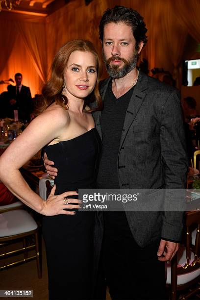 Actress Amy Adams and actor Darren Le Gallo attend The Weinstein Company's Academy Awards Nominees Dinner in partnership with Chopard DeLeon Tequila...