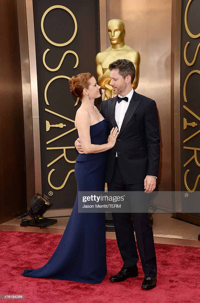 Actress Amy Adams (L) and artist Darren Le Gallo attends the Oscars held at Hollywood & Highland Center on March 2, 2014 in Hollywood, California.