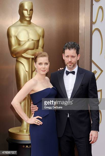 Actress Amy Adams and Darren Le Gallo arrive at the 86th Annual Academy Awards at Hollywood Highland Center on March 2 2014 in Hollywood California