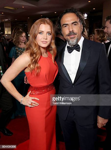 Actress Amy Adams and Director Alejandro Gonzalez Inarritu attends the 73rd Annual Golden Globe Awards at The Beverly Hilton Hotel on January 10 2016...
