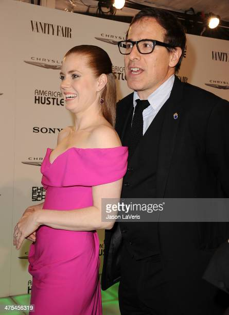Actress Amy Adams and director David O Russell attend the Vanity Fair Campaign Hollywood American Hustle toast at Ago Restaurant on February 27 2014...