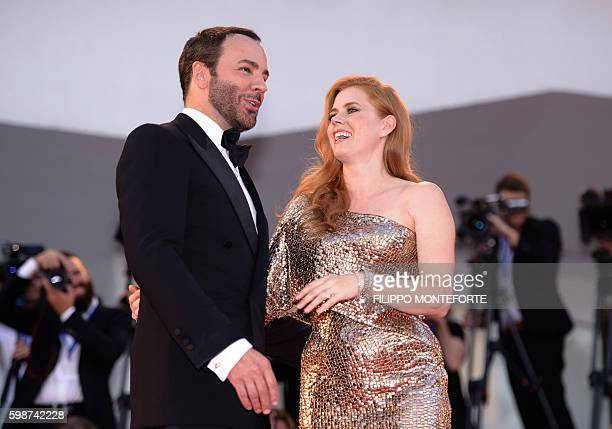 Actress Amy Adams and director Tom Ford arrive for the premiere of the movie 'Nocturnal Animals' presented in competition at the 73rd Venice Film...