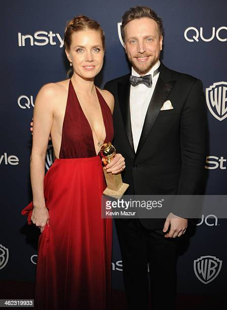 Actress Amy Adams and Editor of InStyle Ariel Foxman attend the 2014 InStyle And Warner Bros. 71st Annual Golden Globe Awards Post-Party at The...