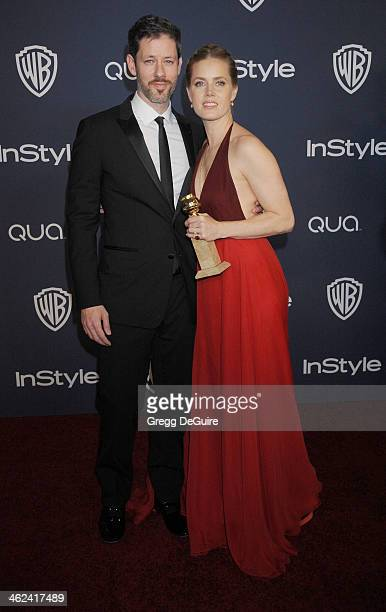 Actress Amy Adams and husband Darren Le Gallo arrive at the 2014 InStyle And Warner Bros 71st Annual Golden Globe Awards postparty at The Beverly...