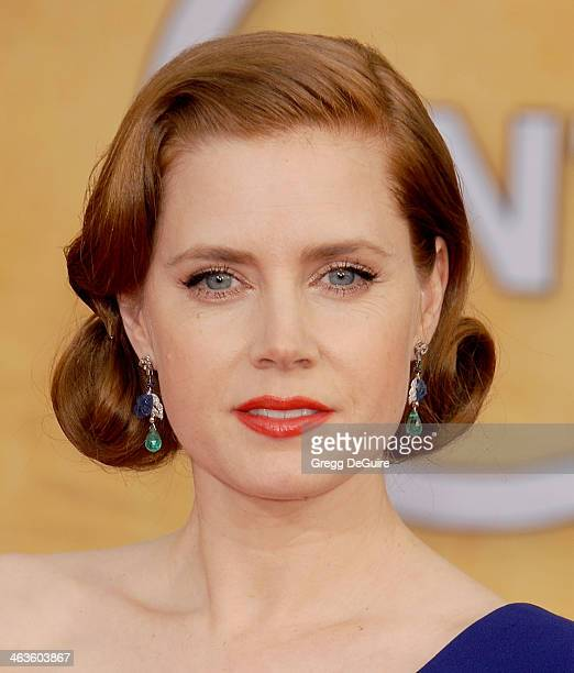Actress Amy Adams arrives at the 20th Annual Screen Actors Guild Awards at The Shrine Auditorium on January 18 2014 in Los Angeles California