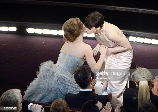 Actress Amy Adams kisses actress Anne Hathaway after Hathaway wins the Best Supporting Actress award for 'Les Miserables' during the Oscars held at...