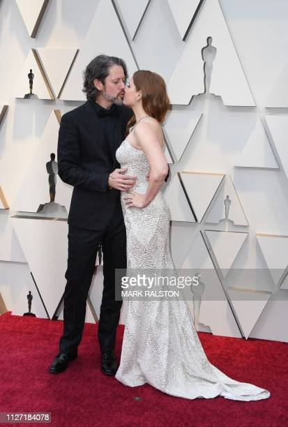 US actress Amy Adams kisses her husband Darren Le Gallo as they arrive for the 91st Annual Academy Awards at the Dolby Theatre in Hollywood...