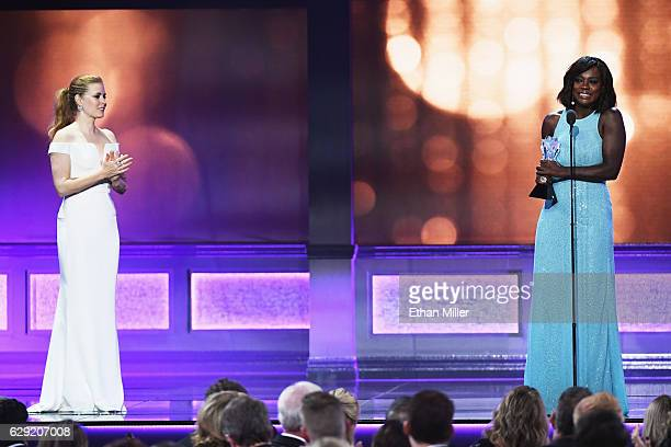 Actress Amy Adams looks on as actress Viola Davis accepts the #SeeHer Award onstage during the 22nd Annual Critics' Choice Awards at Barker Hangar on...