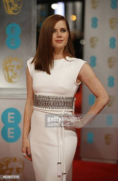 Actress Amy Adams poses for pictures as she arrives on the red carpet for the BAFTA British Academy Film Awards at the Royal Opera House in London on...