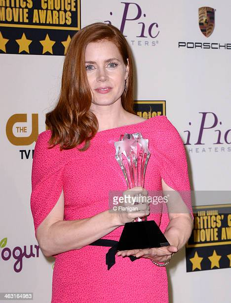 Actress Amy Adams poses in the press room during the 19th Annual Critics' Choice Movie Awards at Barker Hangar on January 16 2014 in Santa Monica...