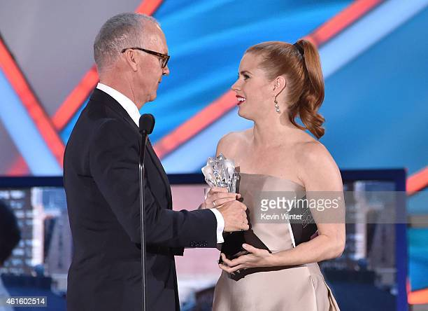 Actress Amy Adams presents the Best Actor award to actor Michael Keaton for 'Birdman' onstage during the 20th annual Critics' Choice Movie Awards at...