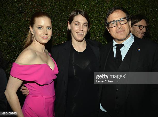 Actress Amy Adams producer Megan Ellison and director David O Russell attend Vanity Fair and Chrysler Toast American Hustle during Vanity Fair...