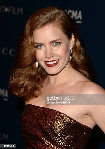 Actress Amy Adams wearing Gucci attends the LACMA 2013 Art Film Gala honoring Martin Scorsese and David Hockney presented by Gucci at LACMA on...