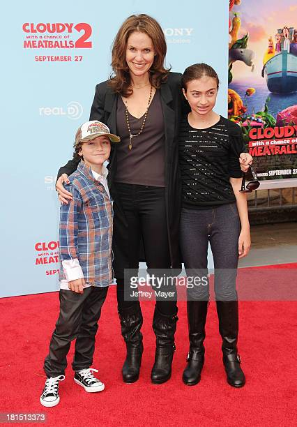 Actress Amy Brenneman and her children Bodhi Russell Silberling and Charlotte Tucker Silberling arrive at the Los Angeles premiere of 'Cloudy With A...