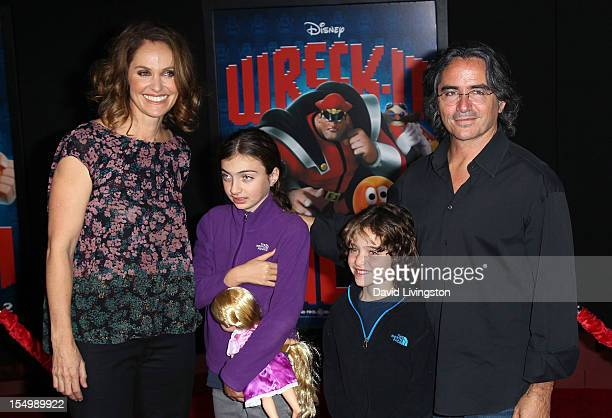 Actress Amy Brenneman and husband director Bard Silberling pose with their children at the premiere of Walt Disney Animation Studios' 'WreckIt Ralph'...