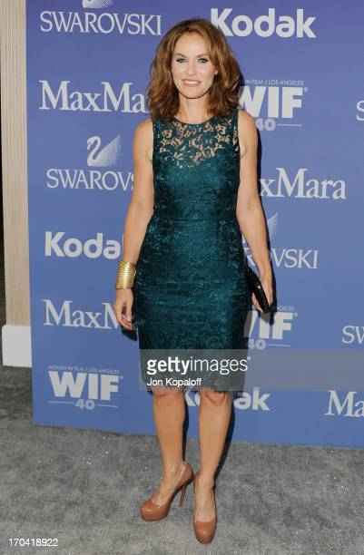 Actress Amy Brenneman arrives at the 2013 Women In Film's Crystal Lucy Awards at The Beverly Hilton Hotel on June 12 2013 in Beverly Hills California
