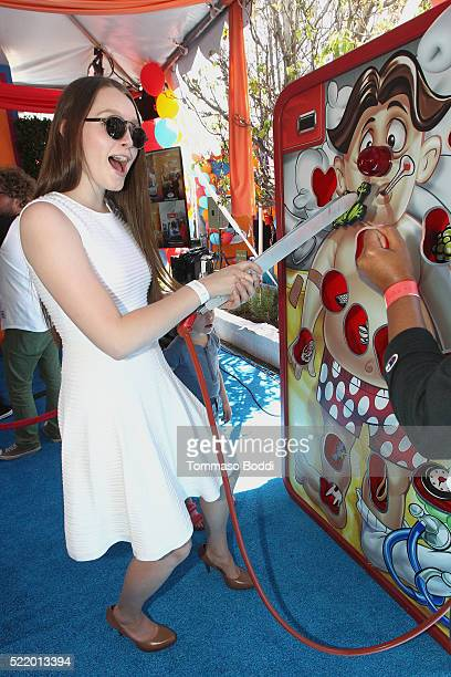 Actress Amy Forsyth attends the John Varvatos 13th Annual Stuart House benefit presented by Chrysler with Kids' Tent by Hasbro Studios at John...