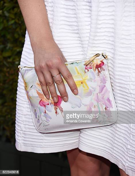 Actress Amy Forsyth clutch detail arrives at the John Varvatos 13th Annual Stuart House Benefit presented by Chrysler with kids' tent by Hasbro...