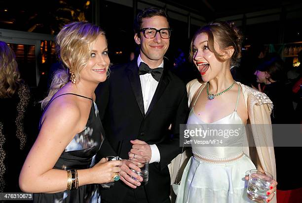 Actress Amy Poehler actor Andy Samberg and musician Joanna Newsom attend the 2014 Vanity Fair Oscar Party Hosted By Graydon Carter on March 2 2014 in...