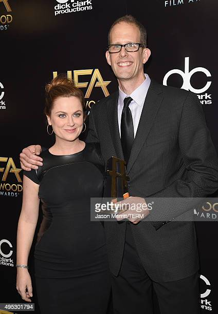 Actress Amy Poehler and director Pete Docter winner of the Hollywood Animation Award for 'Inside Out' pose in the press room during the 19th Annual...