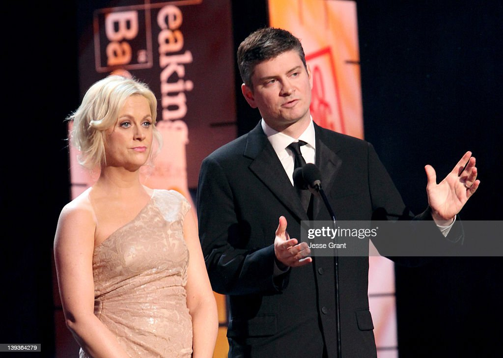 Actress Amy Poehler (L) and writer Michael Schur attend the 2012 Writers Guild Awards at the Hollywood Palladium on February 19, 2012 in Los Angeles, California.