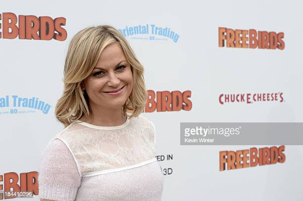 "Actress Amy Poehler attends the premiere of Relativity Media's ""Free Birds"" at Westwood Village Theatre on October 13, 2013 in Westwood, California."
