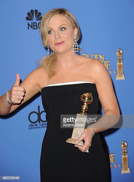 Actress Amy Poehler celebrates winning Best Actress in a Television Series Musical or Comedy for 'Parks and Recreation' in the press room during the...