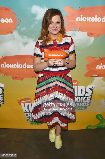 Actress Amy Poehler poses after winning the Favorite Animated Movie award for 'Inside Out during Nickelodeon's 2016 Kids' Choice Awards at The Forum...