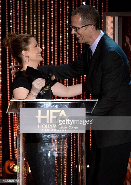 Actress Amy Poehler presents the Hollywood Animation Award for Inside Out to honoree Pete Docter onstage during the 19th Annual Hollywood Film Awards...