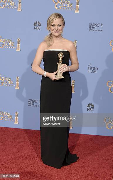 Actress Amy Poehler winner of Best Actress in a Television Series Musical or Comedy for 'Parks and Recreation' poses in the press room during the...