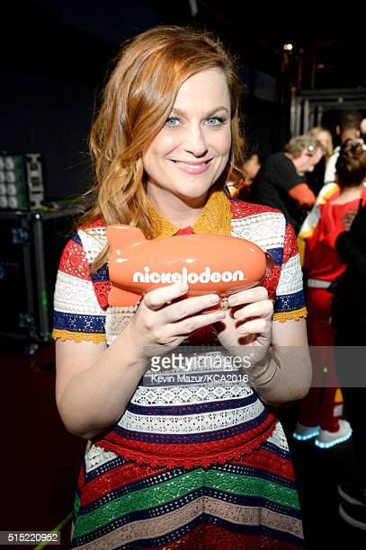 Actress Amy Poehler winner of the Favorite Voice From an Animated Movie award for 'Inside Out' poses backstage during Nickelodeon's 2016 Kids' Choice...
