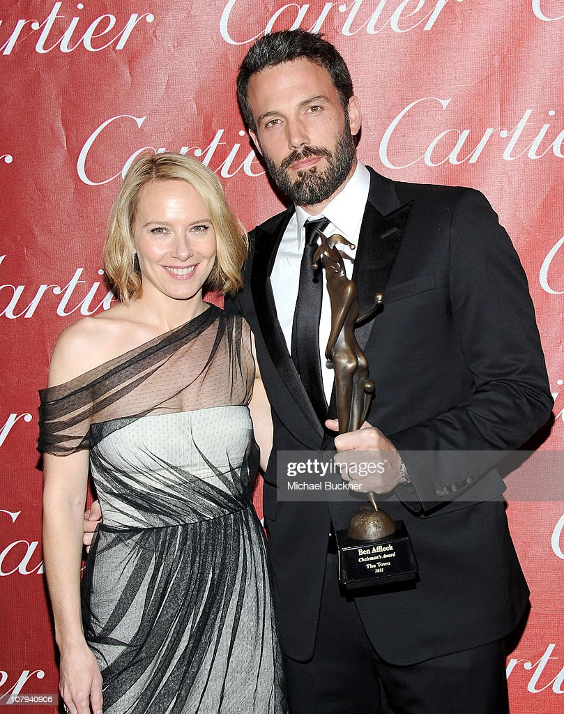 Actress Amy Ryan and Ben Affleck, the 2011 Chairman's Award winner, pose backstage during the 22nd Annual Palm Springs International Film Festival Awards Gala at the Palm Springs Convention Center on January 8, 2011 in Palm Springs, California.