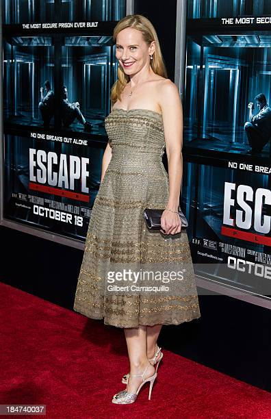 Actress Amy Ryan attends the Escape Plan premiere at Regal EWalk on October 15 2013 in New York City
