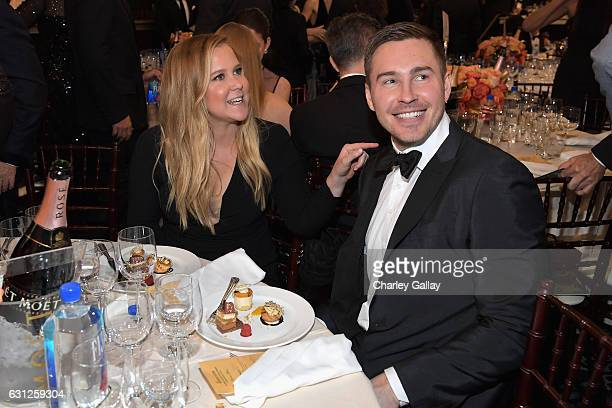 Actress Amy Schumer and Ben Hanisch at the 74th annual Golden Globe Awards sponsored by FIJI Water at The Beverly Hilton Hotel on January 8 2017 in...