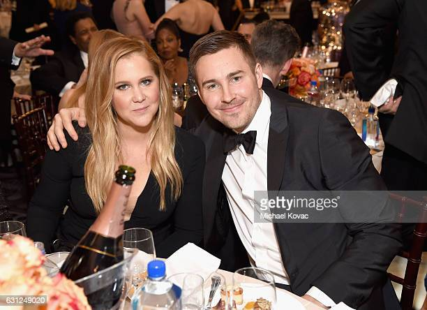 Actress Amy Schumer and Ben Hanisch attend the 74th Annual Golden Globe Awards at The Beverly Hilton Hotel on January 8 2017 in Beverly Hills...