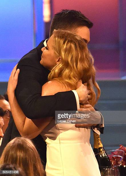 Actress Amy Schumer and Ben Hanisch during the 21st Annual Critics' Choice Awards at Barker Hangar on January 17 2016 in Santa Monica California