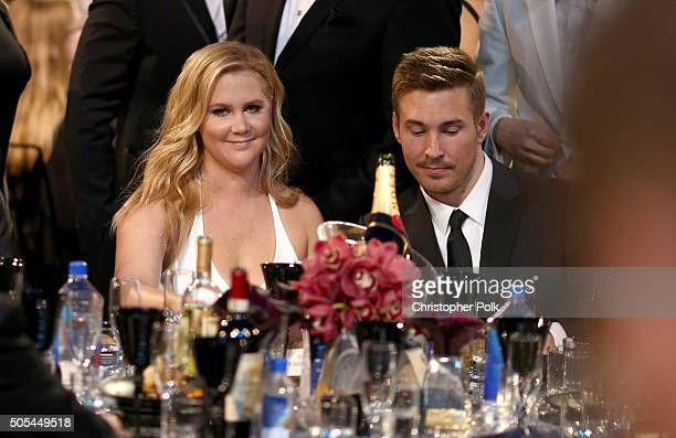 Actress Amy Schumer and designer Ben Hanisch attend the 21st Annual Critics' Choice Awards at Barker Hangar on January 17 2016 in Santa Monica...