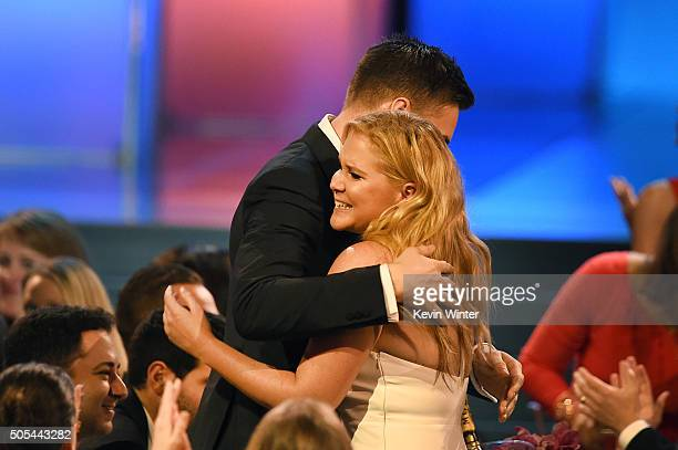 Actress Amy Schumer wins Best Actress in a Comedy for 'Trainwreck' with Ben Hanisch during the 21st Annual Critics' Choice Awards at Barker Hangar on...