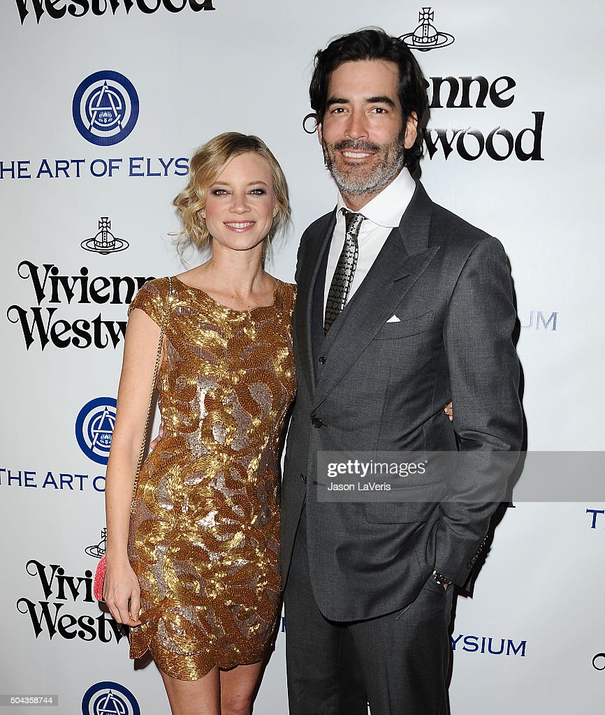 Actress Amy Smart and Carter Oosterhouse attends Art of Elysium's 9th annual Heaven Gala at 3LABS on January 9, 2016 in Culver City, California.