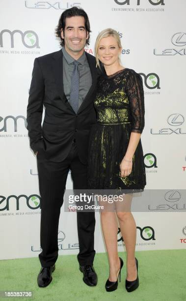 Actress Amy Smart and husband Carter Oosterhouse arrive at the 2013 Environmental Media Awards at Warner Bros Studios on October 19 2013 in Burbank...