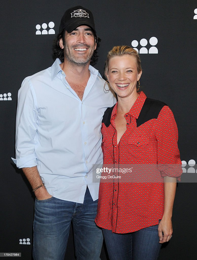 Actress Amy Smart (R) and husband Carter Oosterhouse arrive at the Myspace event at El Rey Theatre on June 12, 2013 in Los Angeles, California.