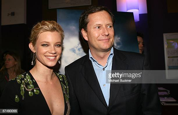 Actress Amy Smart and Michael Burns of Lionsgate attend the premiere of Lionsgate's Peaceful Warrior at the Laemmle Theatre on April 28 2006 in Los...