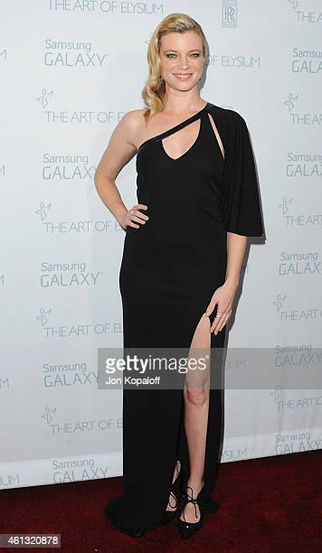 Actress Amy Smart arrives at The Art Of Elysium 8th Annual Heaven Gala at Hangar 8 on January 10 2015 in Santa Monica California