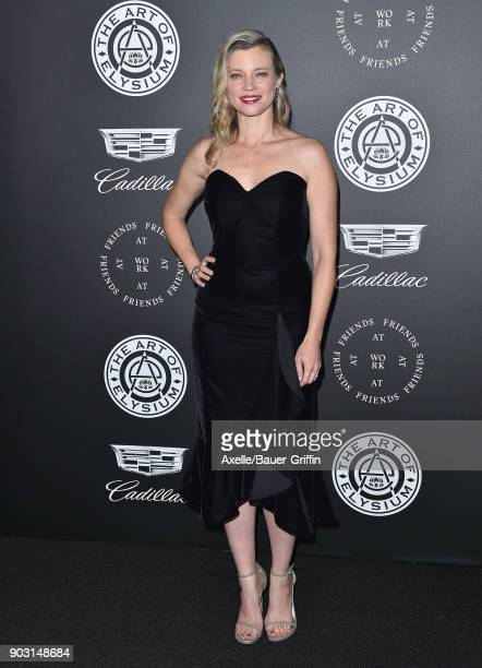 Actress Amy Smart arrives at The Art of Elysium's 11th Annual Celebration Heaven at Barker Hangar on January 6 2018 in Santa Monica California