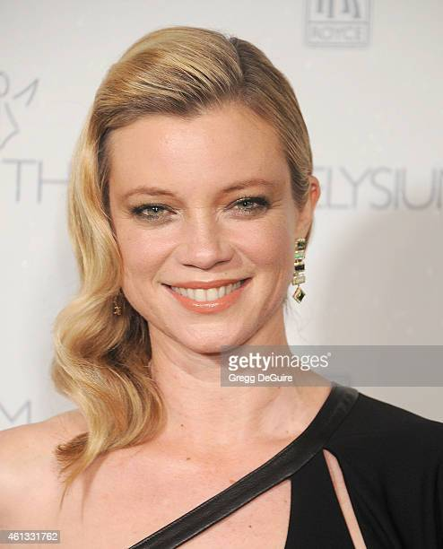 Actress Amy Smart arrives at The Art Of Elysium's 8th Annual Heaven Gala at Hangar 8 on January 10 2015 in Santa Monica California
