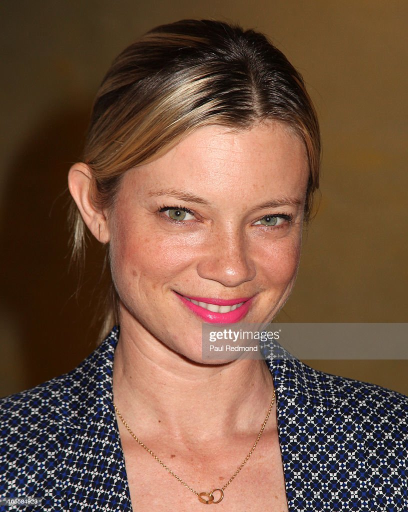 Actress Amy Smart attends 'A Letter To My Dog: Notes To Our Best Friends' cocktail party and book signing at Anthropologie on April 4, 2013 in Beverly Hills, California.
