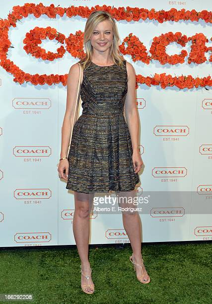 Actress Amy Smart attends the 3rd Annual Coach Evening to benefit Children's Defense Fund at Bad Robot on April 10 2013 in Santa Monica California