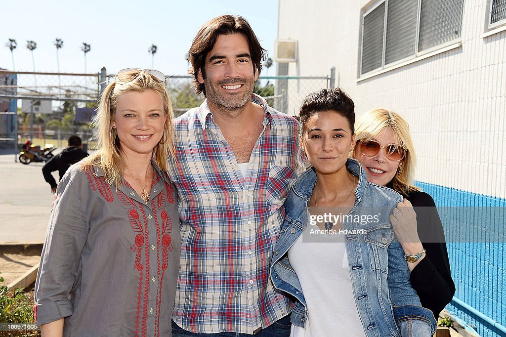 Actress Amy Smart, television personality Carter Oosterhouse, actress Emmanuelle Chriqui and EMA President Debbie Levin celebrate Earth Day with the Environmental Media Association at Cochran Middle School on April 18, 2013 in Los Angeles, California.