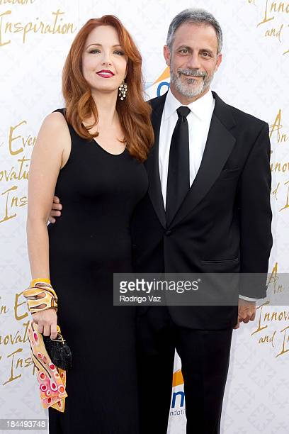 Actress Amy Yasbeck and attorney Michael Plonsker attend the 10th Annual Alfred Mann Foundation Gala on October 13 2013 in Beverly Hills California