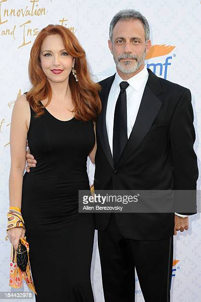 Actress Amy Yasbeck and Michael Plonsker attend the 10th annual Alfred Mann Foundation Gala at 9900 Wilshire Blvd on October 13 2013 in Beverly Hills...